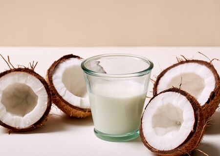 Coconut milk, natural foodstuff, ecology product for cosmetic, food, free from chemical impurities, damage to humans, environment. White tincture, helpful, healthy, herbal, homemade ingredient. Woman