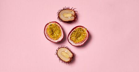 Pink pattern background, banner horizontal with copy space for text. Lychee and passion fruit fresh tasty concept, healthy, natural, organic fruits. Asian food, color product. Isolated composition.