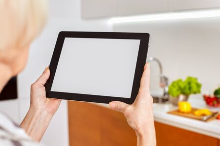 White screen monitor tablet, blank copy space place for text, space, mockup for icon home smart intellectual system. Network details lighting radiators appliances. Woman lady use smartphone to control