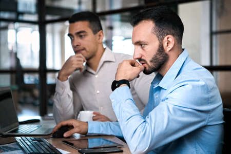Two adult businessman working together in office Фото со стока - 156871344