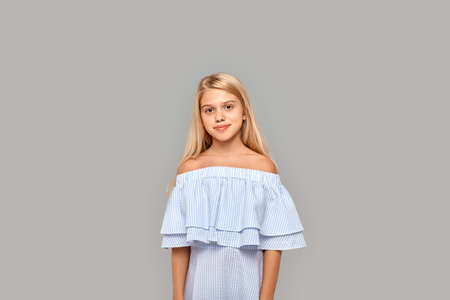 Young girl standing in studio and smiling wide Фото со стока - 158870014