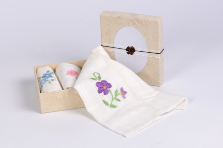 Floral embroidered cotton handkerchiefs in cardboard boxes.