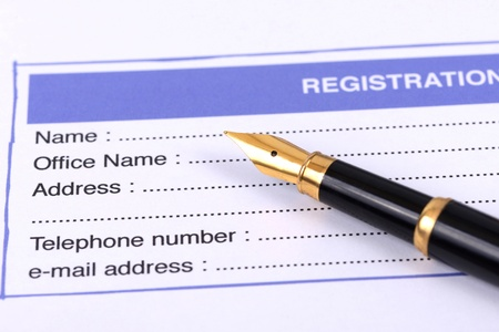 registration: Registration card with pen ready to sign up. Stock Photo