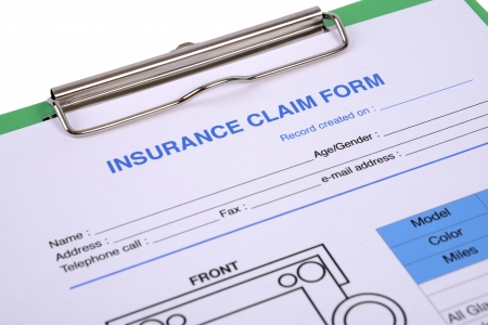 Closeup of insurance claim form on clipboard