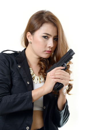Pretty girl in black suit with a gun in her hands  photo