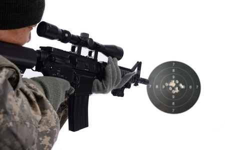 bb gun: Soldier shooting to the target  Stock Photo