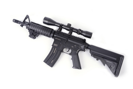 bb: M4 rifle BB gun with telescope on white background