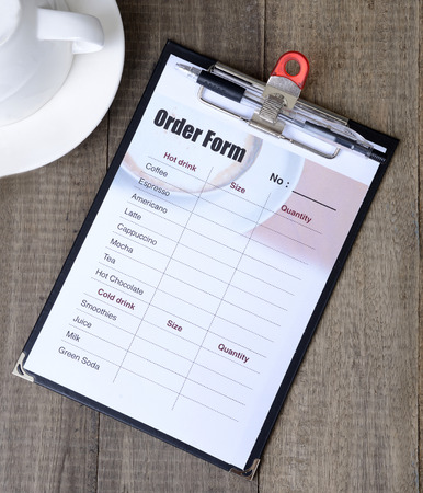 List of drink in an order form on clipboard