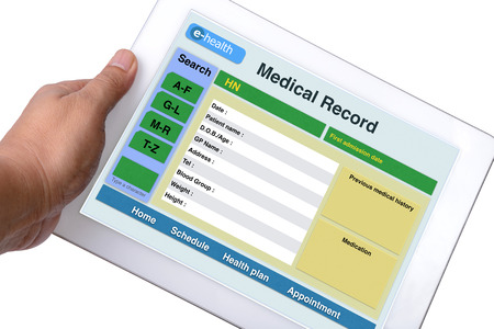 electronic: Patient medical record browse on tablet in someone hand on white background.