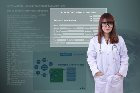 Female doctor stand in front of electronic health\ system