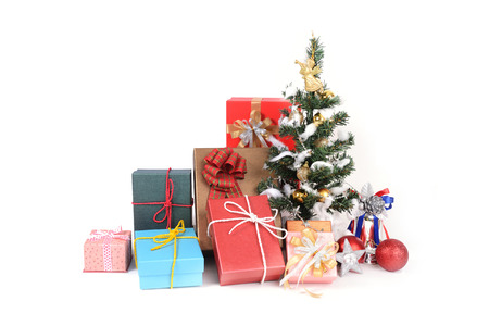 decorated christmas tree by many colourful gift boxes for a happy celebration stock photo - Decorative Christmas Boxes