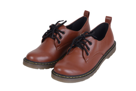 footware: Pair of brown shoes, man footware fashion, on white background.