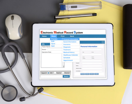 computer accessory: Electronic medical record show on tablet connect to patient information.
