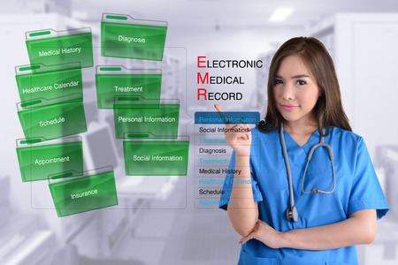 electronic: Female doctor in blue uniform show how electronic medical record work.