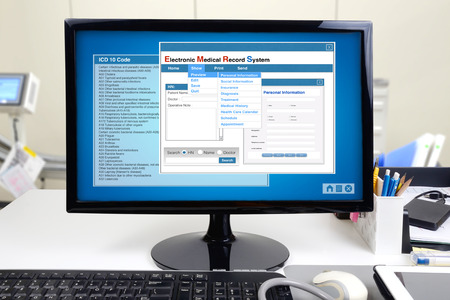 Medical information and electronic medical record system show on computer display.