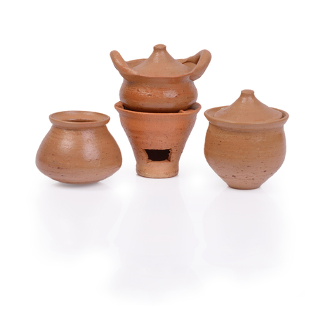 mini oven: Thai handicraft souvenir, mini pot and oven made by clay on white background.