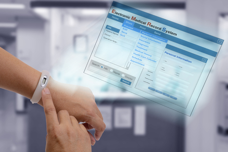 it technology: Using IT technology on hand to show patient information and medical record on screen.