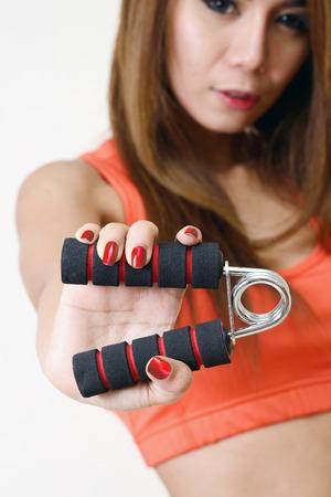 hand gripper: Girl holding gripper in her hand for exerciseing.