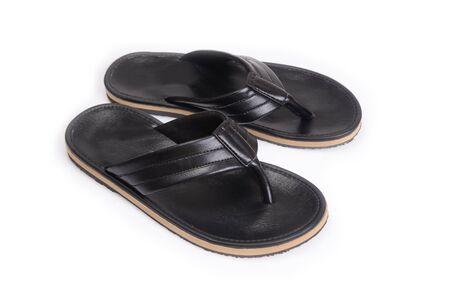 leatherette: Black leatherette slippers on white background. Stock Photo