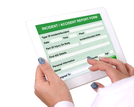 Doctor holding tablet computer in hand that show the report form of Incident or accident information on white background. Stock Photo