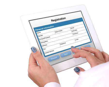 Someones hands holding tablet that showed registration online form on white background.