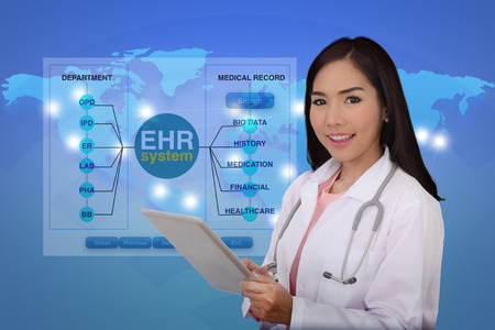 Female doctor holding digital tablet in hand with blue background of world map showing health network linking.