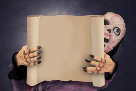 Ghost holding paper poster in hands with dark night background.