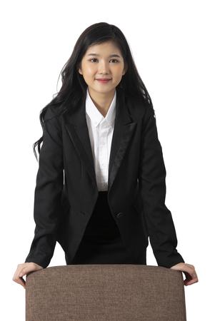 Portrait photo of business woman seem to be confident person put her hands on chair. Banco de Imagens