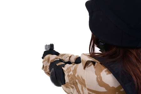 Female soldiers in the military uniform aim at the target on a white background.