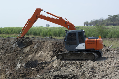 Excavators are working to build ponds for agriculture in rural area.