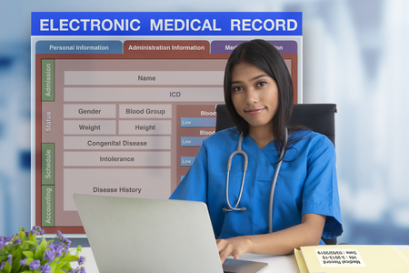 Female doctor working with patient blank form of electronic medicale record system on background.