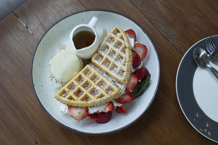 Top view of  strawberry waffles on dish look so testy. 스톡 콘텐츠