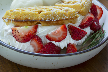 Close-up of strawberry waffles on dish look so testy. 스톡 콘텐츠