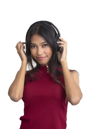 Smiling girl using headphones to listening music by her smartphone.