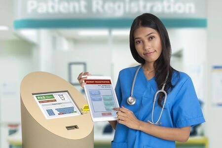 Female doctor showing health information service technology for patient registraion or medical service check in.