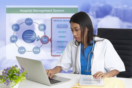 Female doctor working on hospital management system.