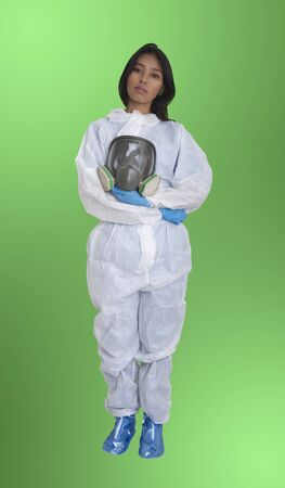 Female officer wearing protective suit on green background.