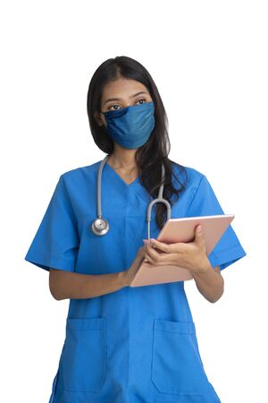 Female doctor wearing mask holding digital tablet in hands on white background.