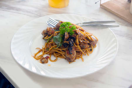 Delicious spaghetti with clams served on dining table.