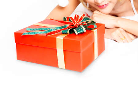 Closed-up photo of woman waiting for happness time to open christmas gift on white background. Stock Photo - 160683957