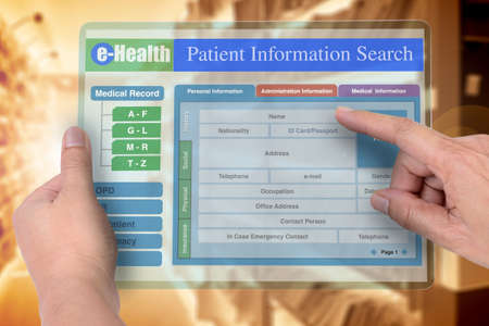 Hands holding transperen digital tablet that showing medical record searching application on screen. Stock Photo