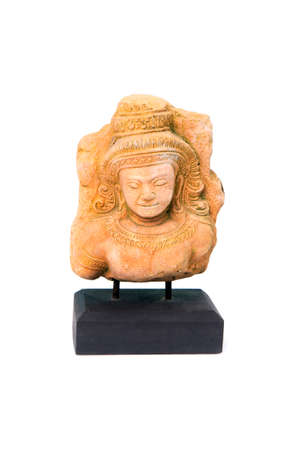 Small apsara statue on a wooden base as souvenir for tourists on white background.