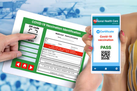 Someone using QR code scan application checking vaccination e-certificate.