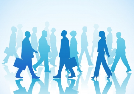 Business people in silhouette walking in different directions
