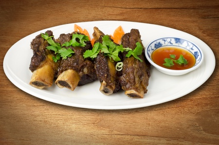 Delicious appetizer thai spare ribs with sweet chilli sauce photo