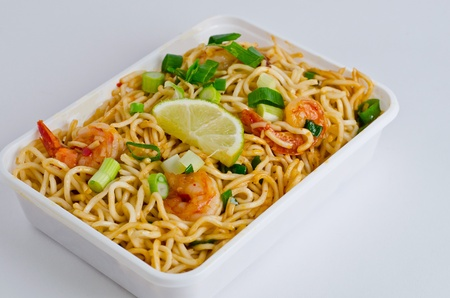 Stir-fry noodle with shrimp on takeaway box. photo