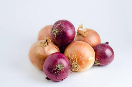 Isolated fresh onions on white background photo