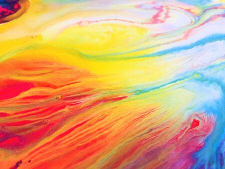 Fondo de textura de pintura acrílica de arte abstracto vertiendo líquido colorido de cerca