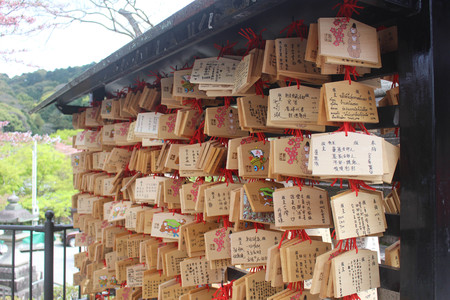 ema: Kiyomizu-dera Temple Kyoto,, Japan - April 11, 2016: A Japanese votive plaque(Ema) hanging in Kiyomizu temple,Ema are small wooden plaques used for wishes by shinto believers.