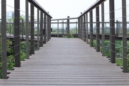 Wood bridge walk in the park.